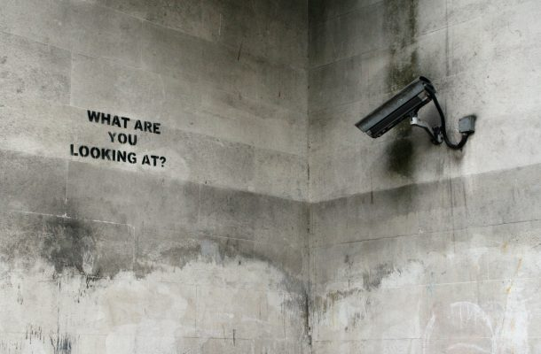 Image of camera capturing graffiti with the text what are you looking at